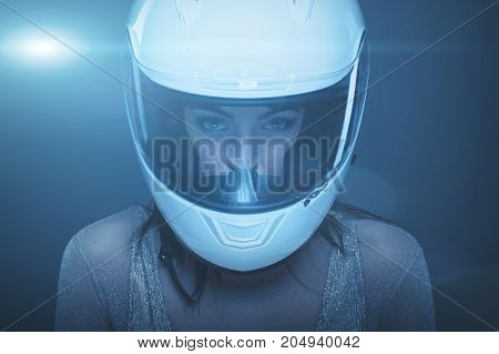 Young fashionable woman in helmet at night portrait high extreme fashion