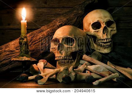 Still Life With Human Skulls And Bones In The Candlelight,haloween Concept