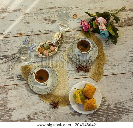 Two Cups Of Turkish Coffee And A Plate With Baklava Top View