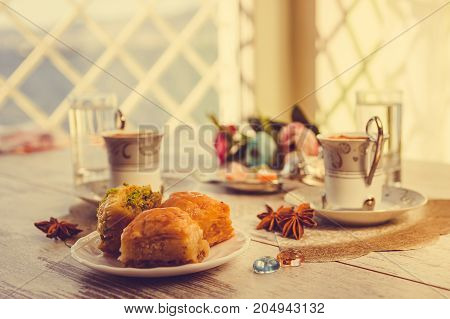 Two Cups Of Turkish Coffee And Baklava