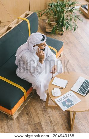Muslim Businessman Talking By Phone