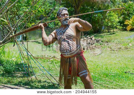 KURANDA, AUSTRALIA - NOVEMBER 07, 2007: Unidentified aborigine actor throws a spear in the Tjapukai Culture Park in Kuranda, Queensland, Australia.