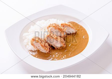 Curry rice with fried chicken on plate