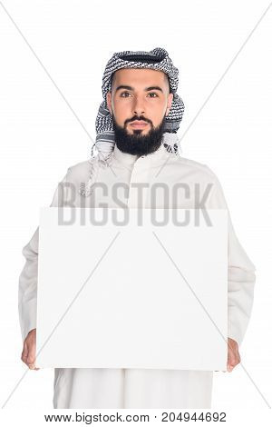 young muslim man holding blank board isolated on white