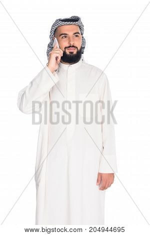 young muslim man talking by phone isolated on white
