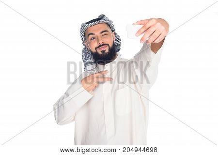 young muslim man taking selfie isolated on white
