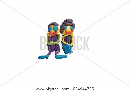 Two cheerful people - man and woman sitting side by side made of plasticine isolated on white background
