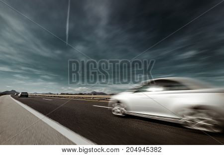 Fast car Highway speed motion with sky background.
