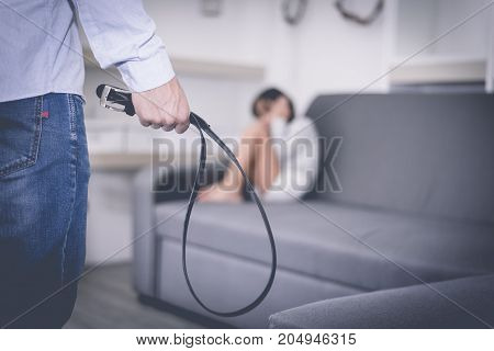 Parents Abuse The Child, Girl Fearing At Her Father, Selective Focus At Belt