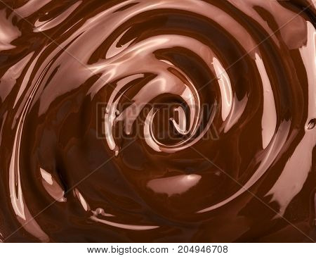 Melted chocolate swirl background, brown colour lighted