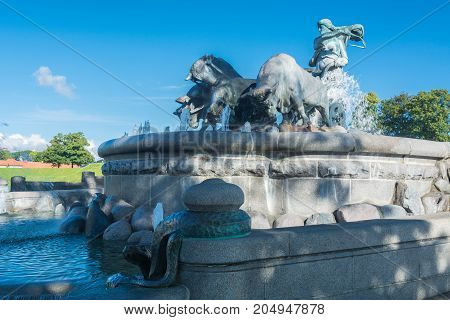 The Gefion Fountain is a large fountain on the harbour front in Copenhagen. It features a group of animal figures being driven by the Norse goddess Gefjon.