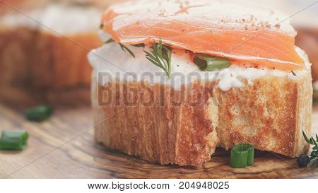small sandwiches with soft cheese and salmon, close up