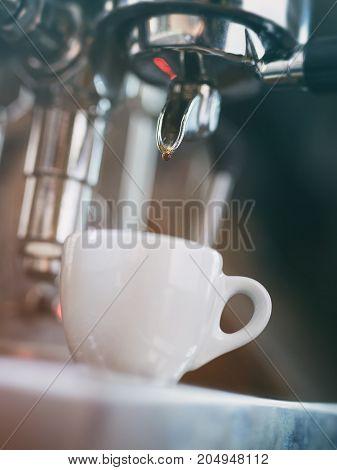 preparing espresso on professional coffee machine, shallow focus grainy photo
