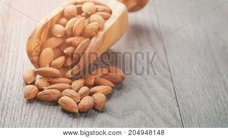 roasted almonds on gray wooden table, shallow focus