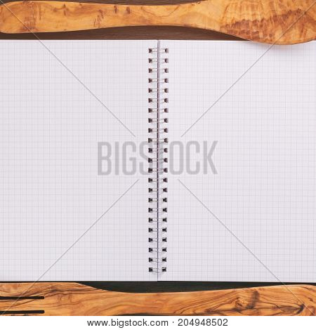 simple blank notepad on rustic wood table, kitchen background