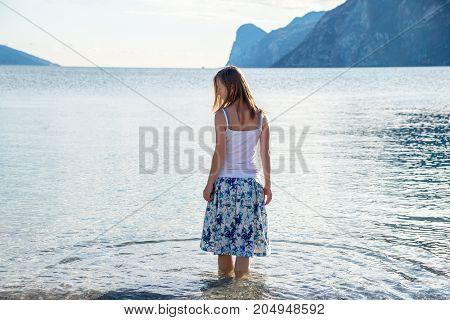 Woman meditating at the lake Garda. Italy
