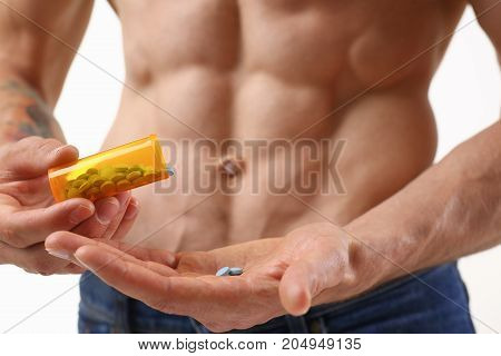 Fitness Man Pours Pills From The Jar Into His Hand Intake Of Hormonal