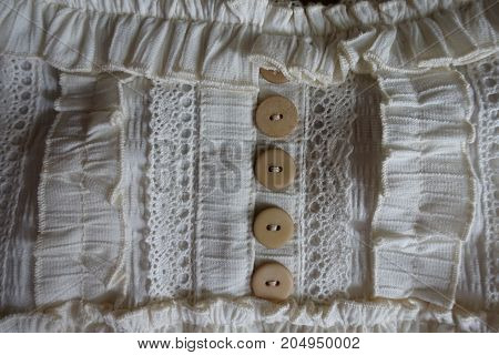 Detail Of Old Fashioned Garment Decorated With Lace, Buttons And Frills