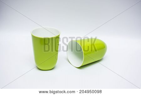 Two mug of plastic. Two green mug of plastic. Isolate on white background.