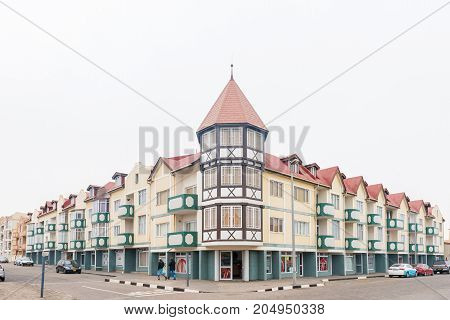 SWAKOPMUND NAMIBIA - JUNE 30 2017: A street scene with apartments and businesses in Swakopmund in the Namib Desert on the Atlantic Coast of Namibia