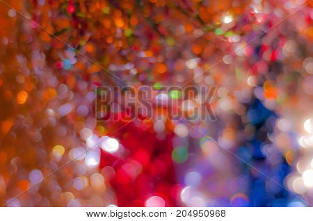 Abstract blurred dark background with bokeh lights