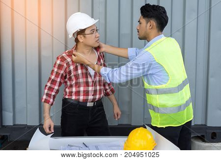 Engineer men quarrel argue controvert after consult at side building construction worker industrial with safety helmet