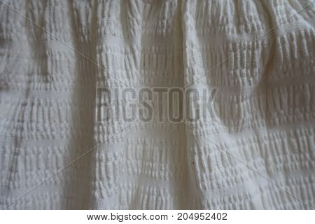 White Simple Cotton Fabric In Soft Folds