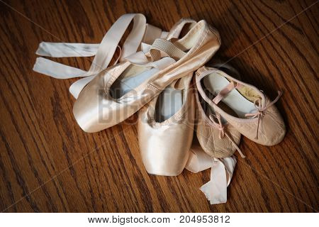 Pointe shoes with toddler sized ballet slippers.