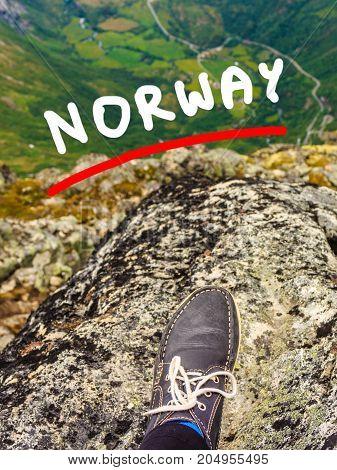 Tourist Feet On Mountain Top