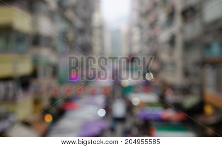 People rush on a busy street of Hong Kong. Blurred scenery for background abstract.