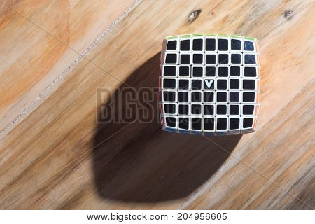 Kuala Lumpur, Malaysia - September 17, 2017:  V-cube On The Wooden Table. V-cube  Is Version Of Rubi