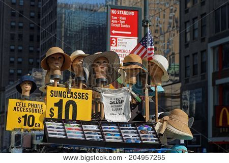 NEW YORK CITY, USA, September 10, 2017 : Selling hats among the skyscrapers of 42nd street. Manhattan is the most densely populated borough of New York City, its economic and administrative center, and its historical birthplace.