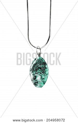 Turquoise pendant on silver chain isolated over white