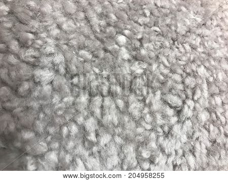Texture of gray and fluffy synthetic fur