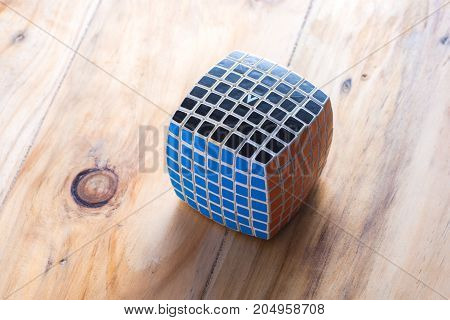 KUALA LUMPUR MALAYSIA - SEPTEMBER 17 2017: V-Cube on the wooden table. V-Cube is version of Rubik's cube invented by a Greek inventor Panagiotis Verdes.