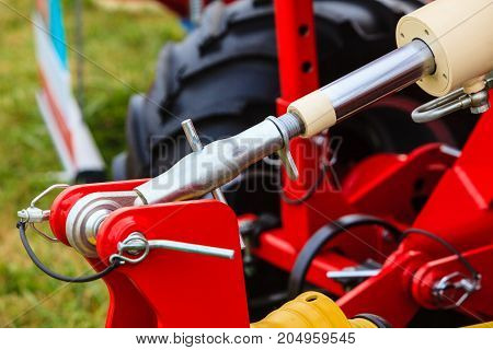 Agriculture equipment concept. Industrial detailed pneumatic hydraulic machinery made of steel closeup