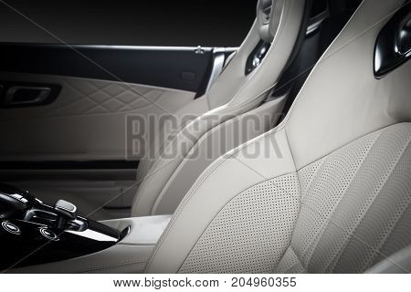 Race seats in modern luxury car, frontal view, white leather, clipping path for windows included