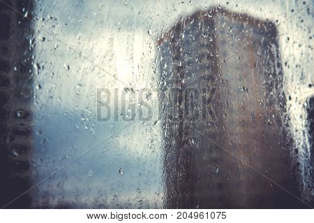 Autumnal weather rainywater drop on windowDepressive and loneliness emotion