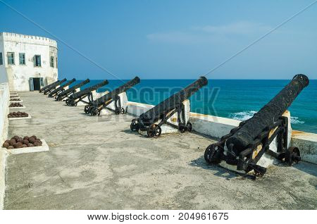 Famous slave trading fort of colonial times Cape Coast Castle with old cannons and white washed walls, Cape Coast, Ghana, West Africa.