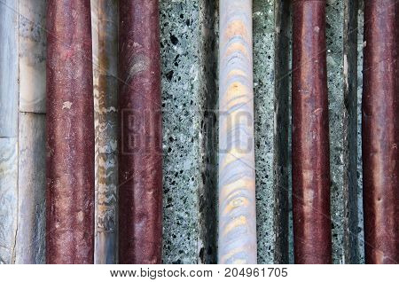 Detail of various colors of vertical marble columns.