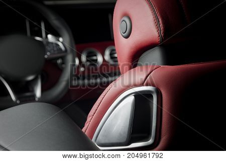 Modern luxury race car red leather interior. Sport seats details