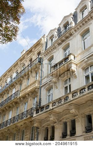 Facade Of An Old Classic Mansion In The City Of Bordeaux, France