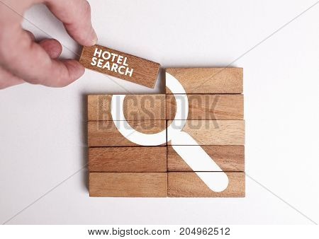 Business, Technology, Internet And Network Concept. Young Businessman Shows The Word: Hotel Search