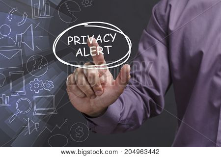 Business, Technology, Internet And Network Concept. Young Businessman Shows The Word: Privacy Alert