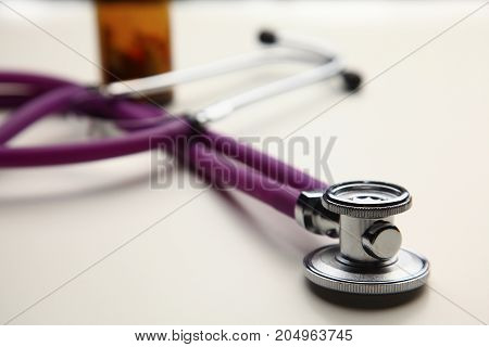 Closeup of a medical stethoscope, isolated on white background.