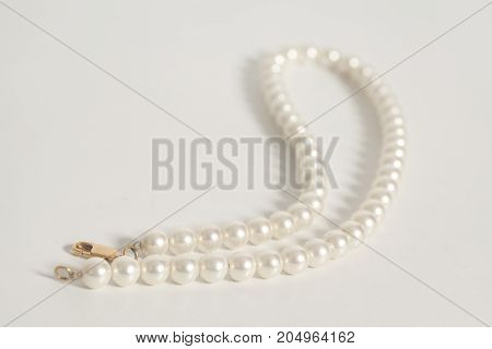 Pearl necklace on a white background .