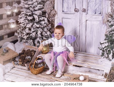 Horizontal shot of little girl wearing fairy's costume at Christmas.