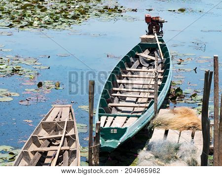 Local traditional fishing long tail boat of fisherman in lake river in nature Phatthalung Thailand.