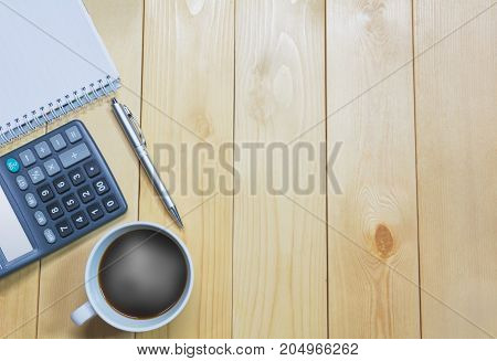 Top view office table with paper and coffee and calculator and pen for business and copy space.