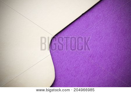 Purple craft paper surface with cardboard edge. Border between two territories